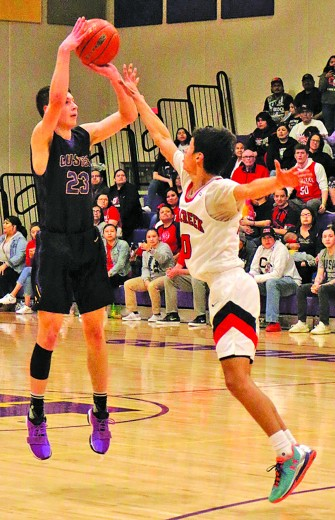 Jace Kelley rises up for a three-pointer over a Crow Creek defender during last week's SoDak 16 game in Kadoka. Kelley had a game-high 28 points in Custer's season-ending loss.