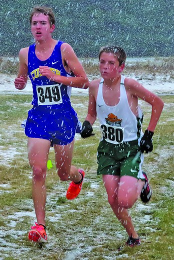 Maya Tennyson, left, and Brit Wheeler run in the varsity race at the Region 5A cross country meet at Lead/Deadwood on Saturday. The girls team took second in the region and qualified for the state meet at Hart Ranch near Rapid City this weekend.