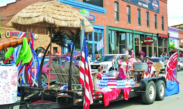 Dallas Alexander Construction was one of several entries into the July 3 parade down Main Street Hill City. The parade was part of a day of activities in Hill City, as the town celebrated Independence Day. Large crowds gathered on both sides of the street to watch the parade.