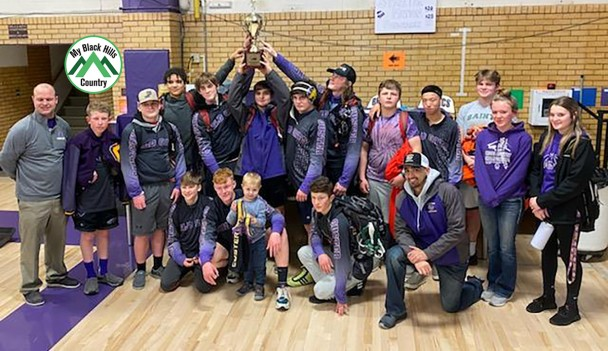 The Custer wrestling team displays the first place trophy it won at the Black Hills Conference Tournament in Belle Fourche on Saturday. From left, back, are head coach Jared Webster, Leighton Sander, Lane Geisner, Mikael Grace, Jonathan Lewis, Parker Noem, Zayne Severyn, Ty Dailey, Ryder Bailey, Pierce Sword, Eli Steele, student managers Kadense Dooley and Payton Noem; front, Tray Weiss, Sterling Sword, Waylon Webster, Landon Woodward and assistant coach Skylair Jaure.